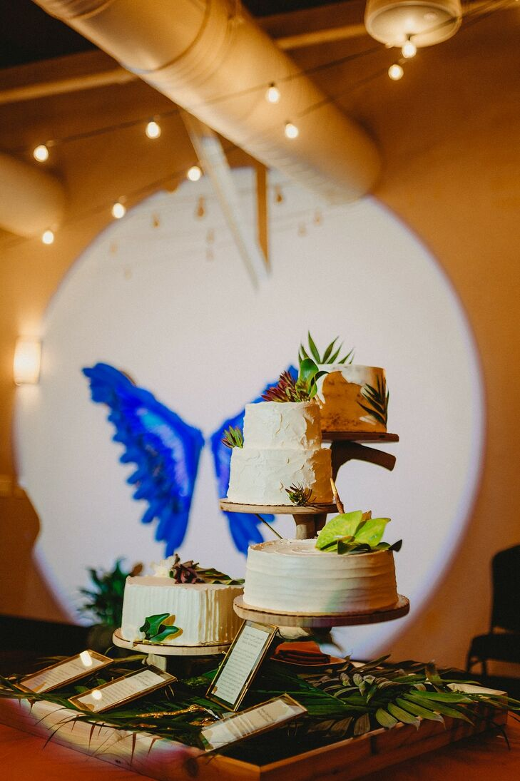 Modern Wedding Cake Display with Tropical Leaves