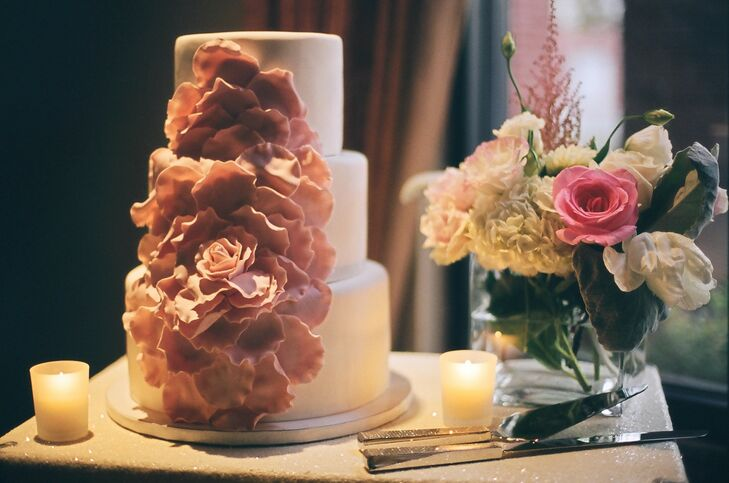 Pink Sugar Flowers on Three Tier White Cake