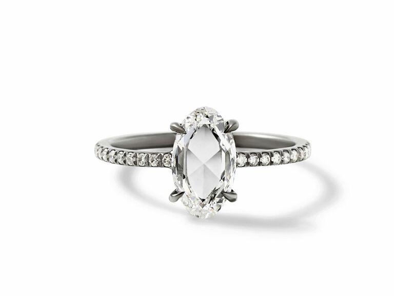 Rose cut diamond set in 18K blackened white gold with white diamonds