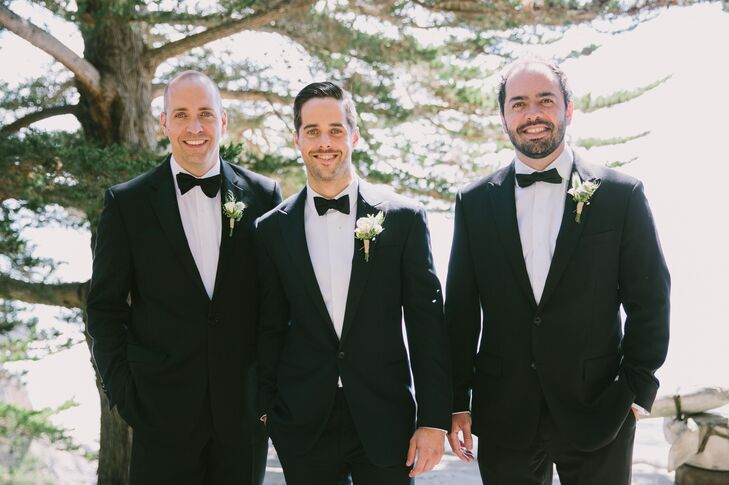 Kevin and his two groomsmen wore midnight blue Ralph Lauren tuxedos with black bow ties and white blossom boutonnieres.