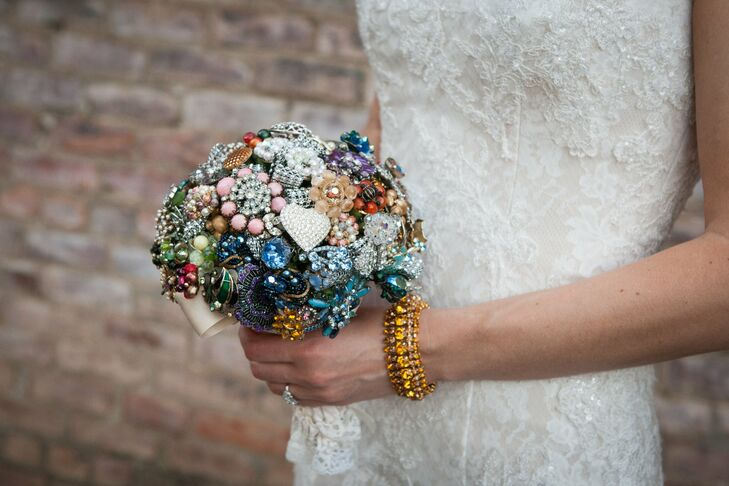 """""""I collect vintage jewelry, so my mom and I went to an antique expo and chose some beautiful vintage rhinestone pieces for all my looks,"""" Laura says. """"I wore brooches as hair pieces and also had all my vintage brooches made into a multicolored brooch bouquet."""""""