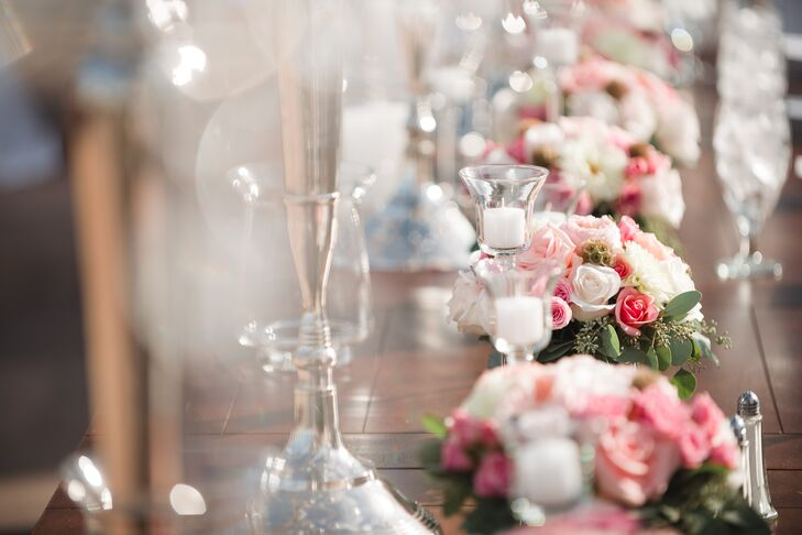 Flower arrangements on the head table included white dahlias, pink roses, pink ranunculus and scabiosa pods.