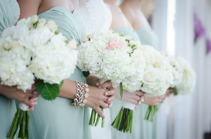 The bridesmaids carried simple bouquets of hydrangeas and roses in ivory and pink.