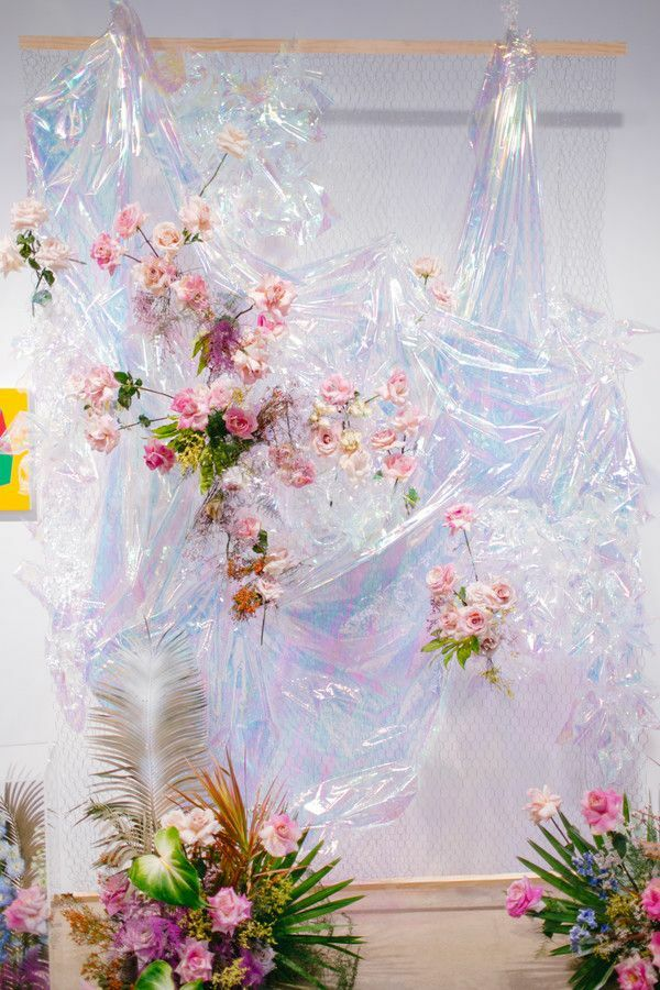 Iridescent plastic backdrop with pink roses