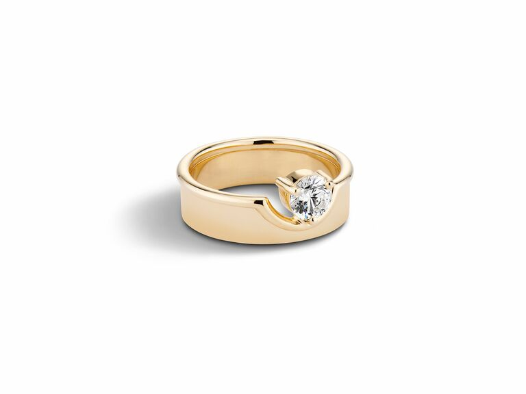diamond engagement ring with thick yellow gold band and floating round diamond