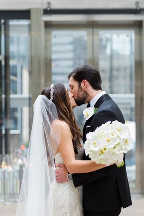 Classic Bride and Groom with All-White Orchid Bouquet and Boutonniere