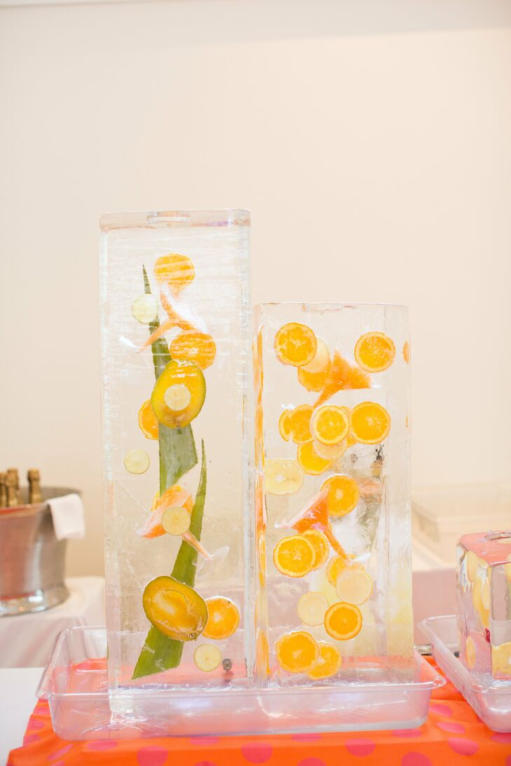 The couple incorporated these unique citrus ice sculptures into the reception decor.