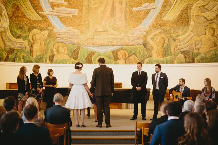 """The ceremony was intimate and very personal,"" Louise says. ""Two friends sang and played guitar, and the wedding officiant had made a ceremony just for us with personal anecdotes and poems. It was a very special moment to share with family and friends!"""