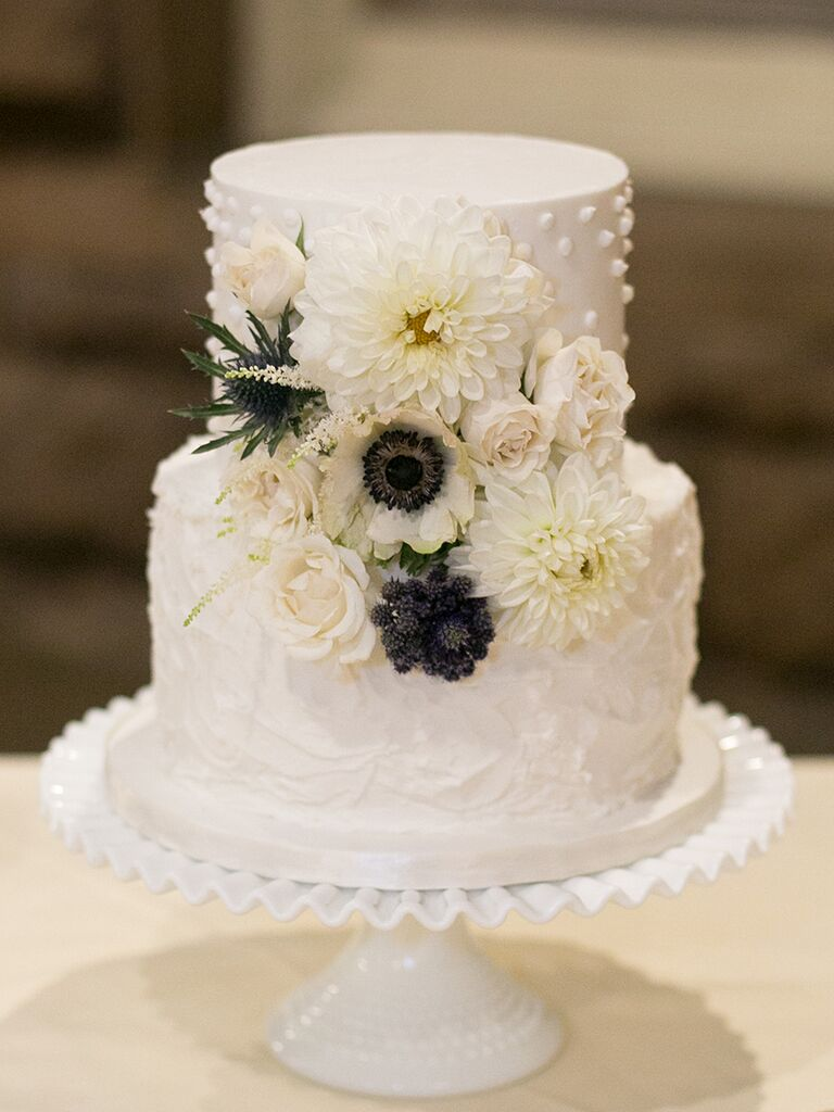 Small Swiss dot wedding cake with thistle, anemones and dahlias