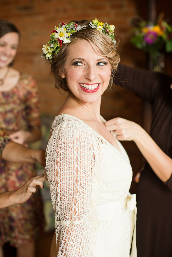Carlyn wore a crown assorted with a variety of colorful wildflowers, adding a bohemian touch to wedding day look. The subtle pink blush and red lip makeup had the natural look Carlyn went for.