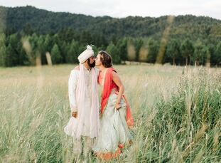 Sarah Bowen and Neil Patel wed on the bride's brother's property in Moscow, Idaho, blending their family traditions into a unique and colorful Western