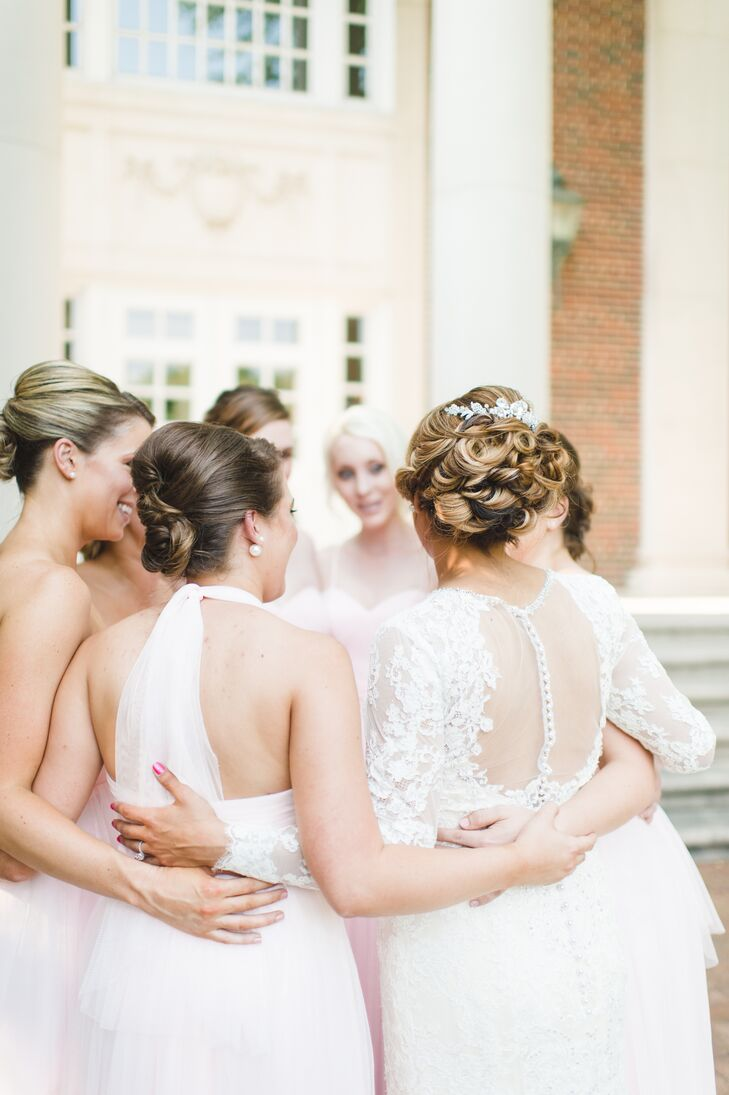 Melissa and her bridesmaids wore their hair in classically romantic twisted updo hairstyles. Melissa stood out with lots of intricate curls that were topped with an embellished accessory; for her ceremony she wore a cathedral-length veil.