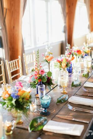 Dining Table with Colorful Centerpieces and Vintage Glassware
