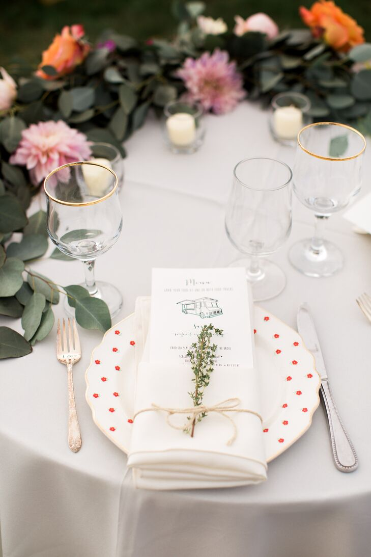 Samantha and Myles hoped to achieve an atmosphere of laid-back elegance, and details like mismatched vintage china ensured that they did. Each table boasted its own set of dinnerware, with each plate adorned with an illustrated menu and sprigs of fragrant fresh herbs.