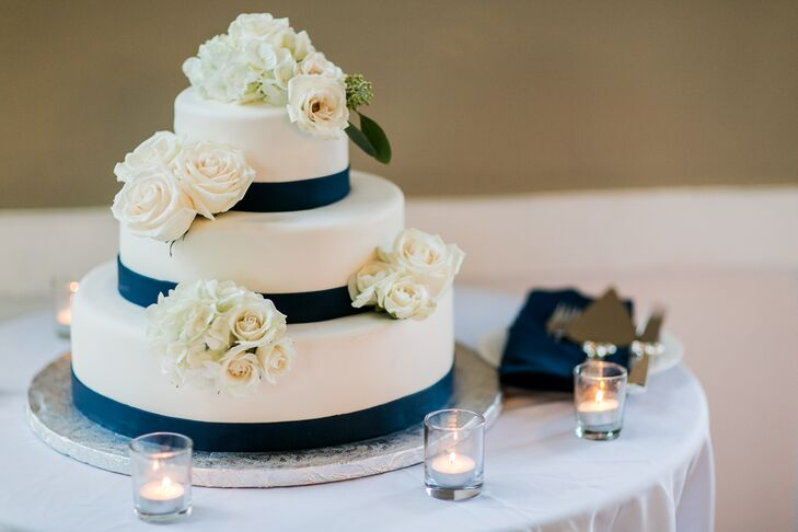 Navy and White Tiered Cake With White Roses