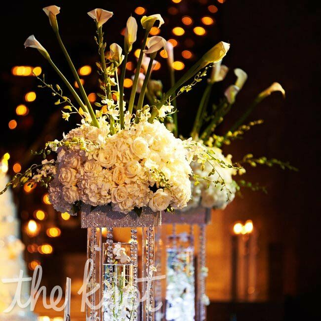 Soaring arrangements of roses, hydrangeas and calla lilies got their height from glittering pedestal vases.