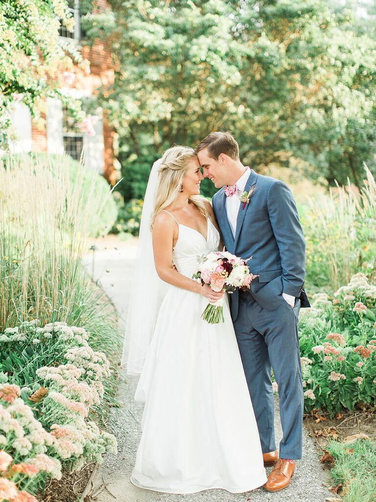 bride and groom in garden