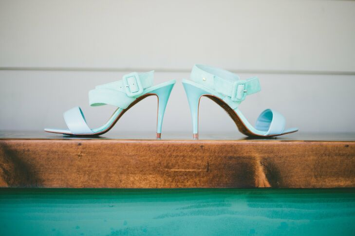 For her something blue Megan wore these cute strappy pale blue heels by Ted Baker.