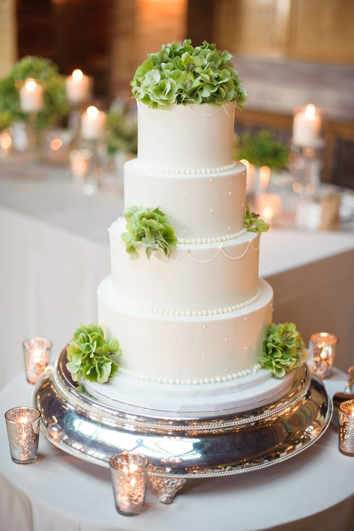 Bittersweet Pastries baked up this four-tier green and white confection for the couple, complete with fondant and green hydrangeas.