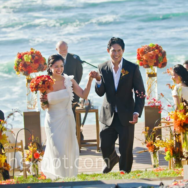 Larissa and Red said their vows on the deck while guests sat in chairs on the grass overlooking the ocean.