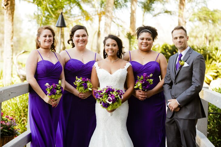 Marzetta's three bridesmaids wore floor-length purple Bill Levkoff dresses with ruch detailing, spaghetti straps and a sweetheart neckline.