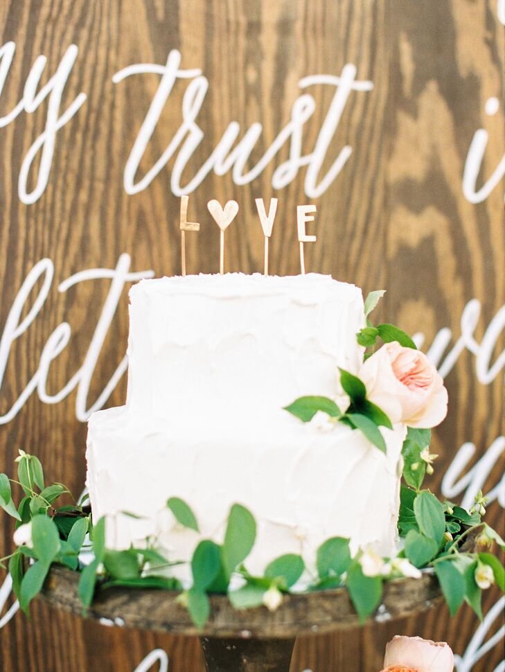 Taylor and Caleb's small two-tier cake was perfect for dessert. One tier was chocolate cake with salted caramel filling and the other was a white cake with a strawberry and cream filling. It was all topped with stucco-textured buttercream and lots of fresh greenery.