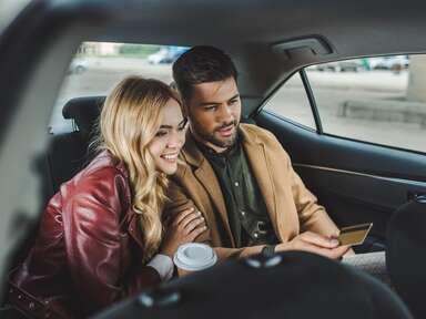 couple car backseat smiling