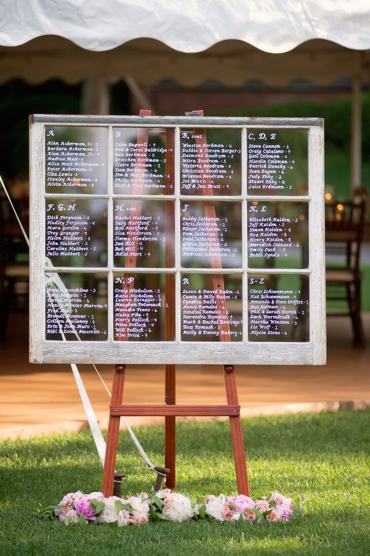 Instead of traditional escort cards, Nellie's mom wrote everybody's name and seating assignments on a vintage window pane.