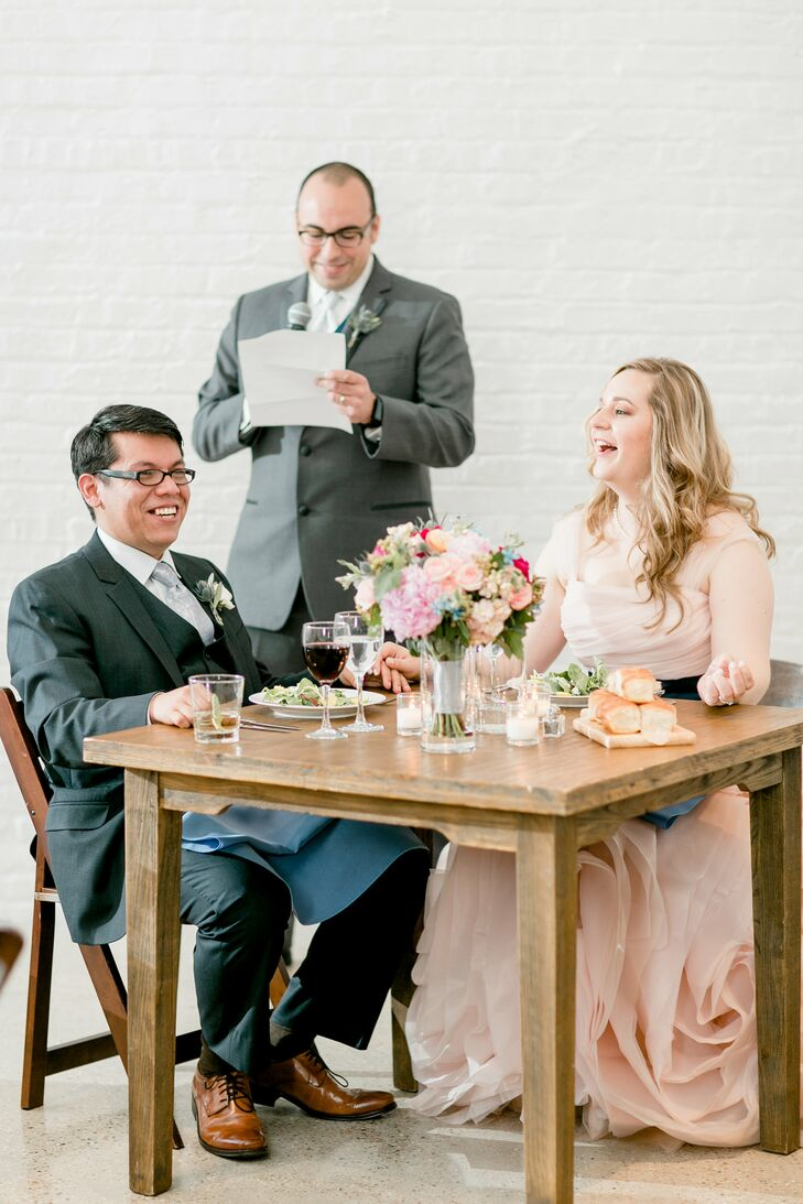 Mary and Jav sat at their own small table during the reception at Chez in Chicago, Illinois.