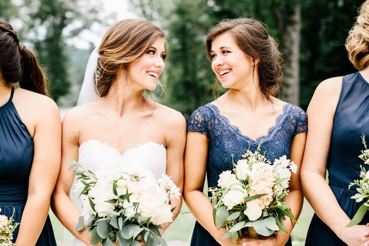"Rachel's twin sister stood out in a navy lace bridesmaid dress that featured a chiffon skirt and cap sleeves. ""It was my favorite dress of all—it looked stunning on her,"" Rachel says."