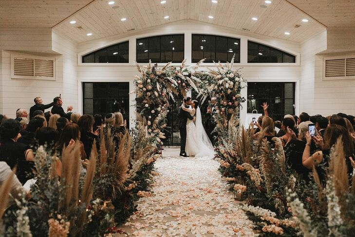 Modern, Romantic Indoor Ceremony with Flower Arch, Pampas Grass and Rose Petals