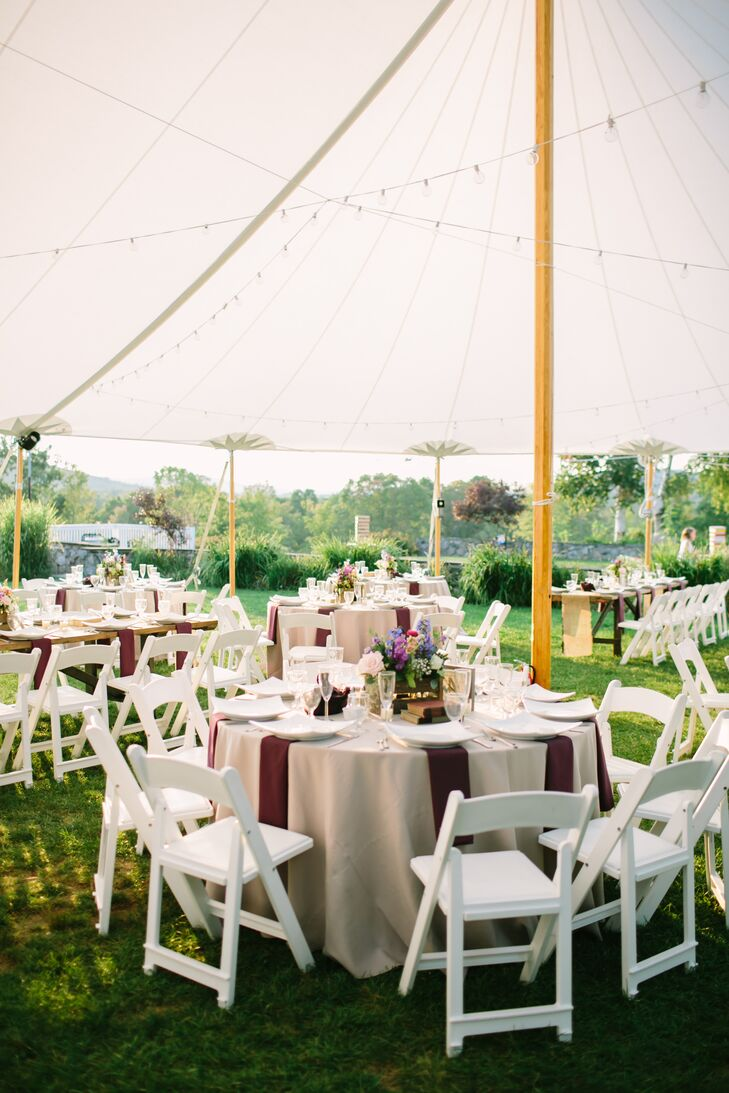 "With a relaxed yet sophisticated soiree in mind, Candlelight Farms Inn could not have been a more suitable spot to say ""I do"" for Kimberly and Peter. Between its breathtaking scenery and historic country charm, the venue checked all boxes, providing the rustic, laid-back feel the couple were after. Making the most of the setting, the pair opted for an open-air reception with panoramic views of the grounds."