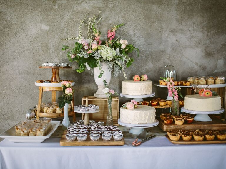 Rustic Floral Dessert Bar With Cakes And Mini Pies