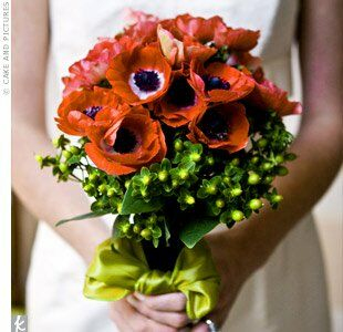Libby carried a bouquet of red anemones with green hypericum berries wrapped with wide chocolate-colored velvet ribbon, which she put together herself.