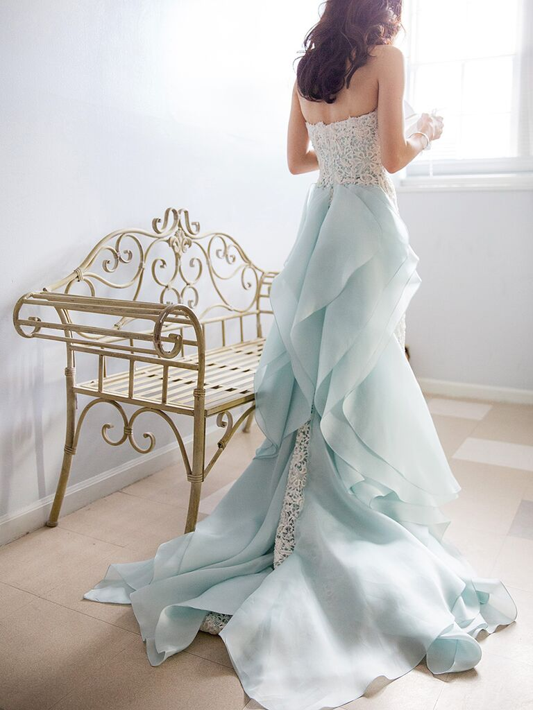 Light blue Oscar de la Renta wedding gown with a lace column silhouette and organza ruffle train