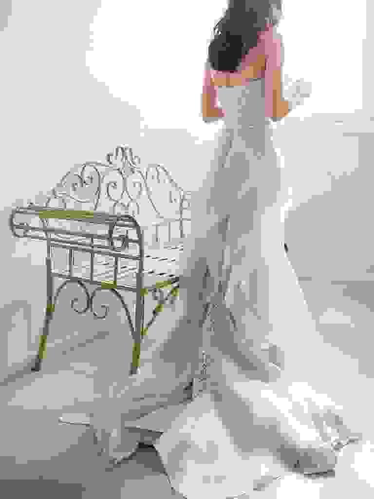 Light blue Oscar de la Renta wedding gown with a lace column silhouette and organza ruffle train