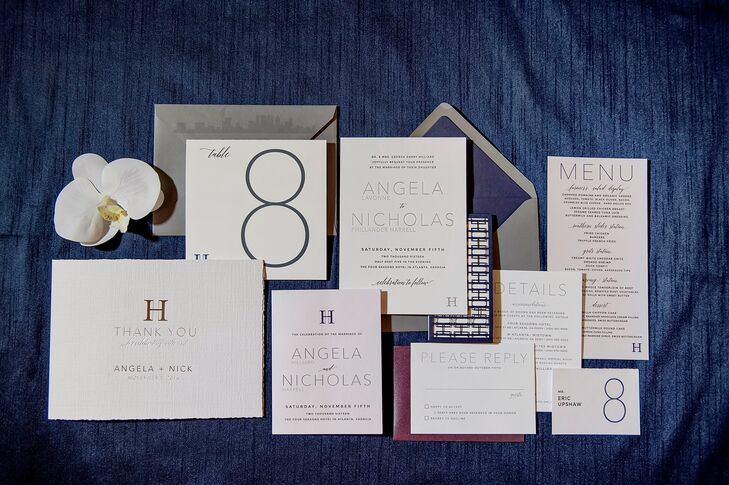 """Since Angela's and Nicholas's last names start with an H, their stationery incorporated two interlocking Hs. """"This design appeared on all the stationery,  including a custom die-cut band for the invitations, the photo frames for the photo booth and the cake topper, and it was also produced as a silver monogram for the dance floor."""