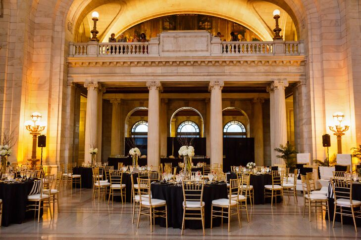 The reception space was held in the same ballroom as the ceremony, transformed with dining tables and chiavari chairs for the evening.