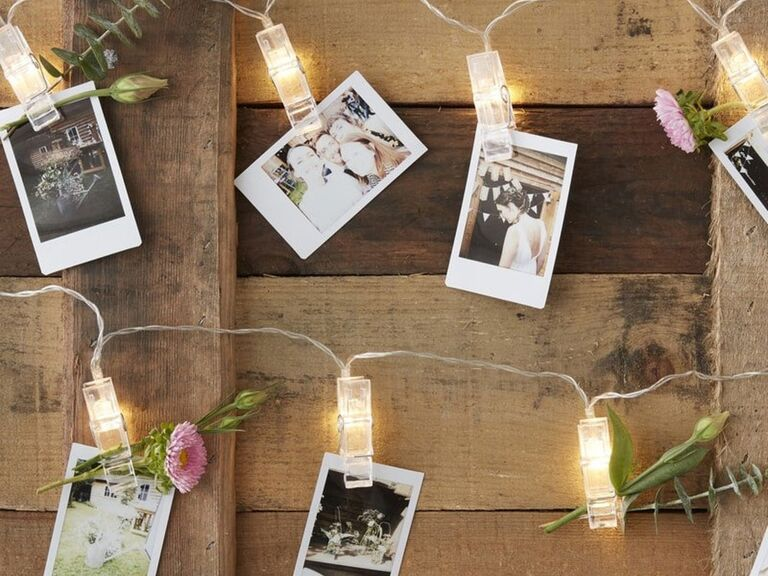 String lights with photo pegs budget friendly decoration idea