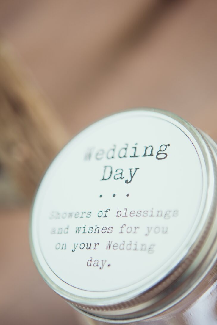 """Friends and family filled a mason jar with handwritten words of wisdom and wishes for the newlyweds, such as """"Always give yourselves time for a date night,"""" and """"Never go to bed angry at each other,"""" and """"Always keep kissing each other."""""""