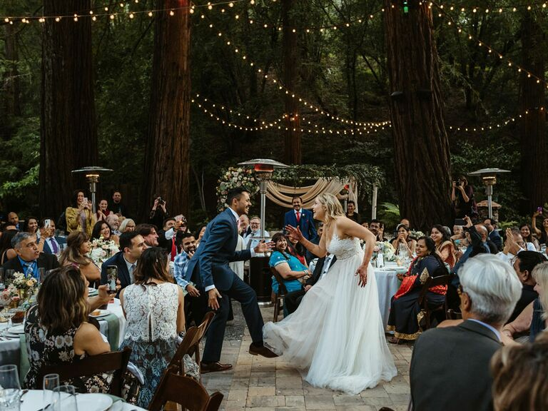 Bride and groom's first dance at outdoor wedding reception
