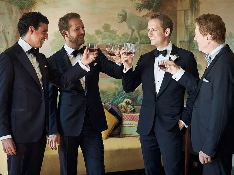 Groom and groomsmen toasting before the wedding ceremony