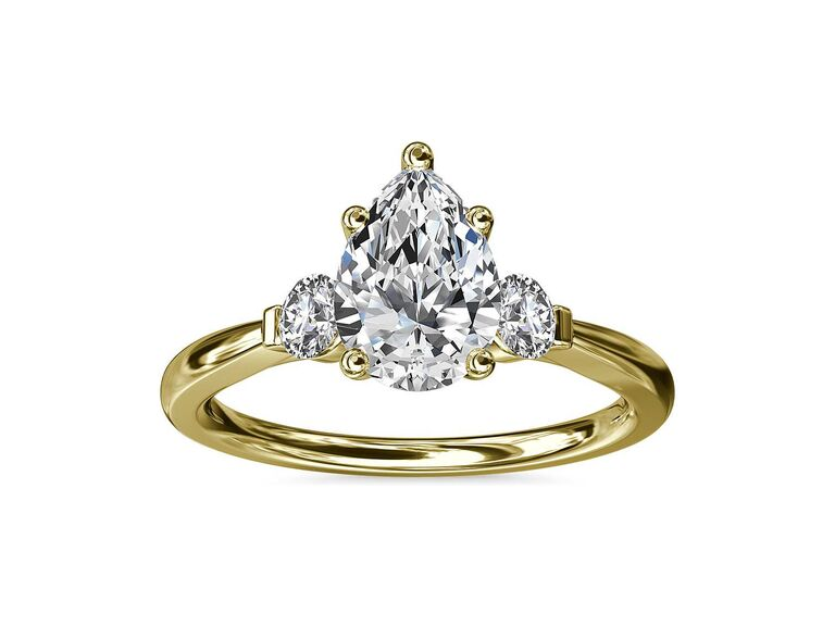 Blue Nile petite three-stone diamond engagement ring in 18K yellow gold