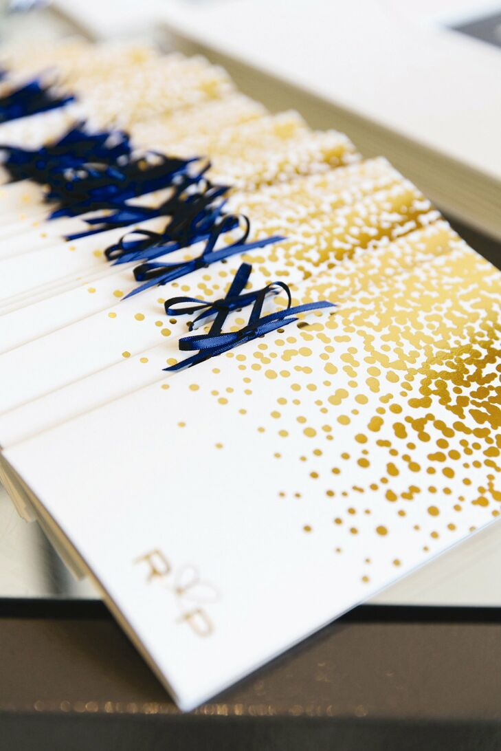 The ceremony program books were decorated with a gold fleck pattern, custom monogram and navy ribbon for a Kate Spade inspired look.