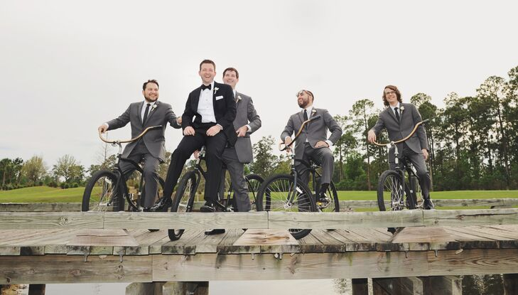 Jarrett wore a traditional, slim-fit tuxedo with a bow tie, while his groomsmen wore slim-fit, black suits with skinny ties.