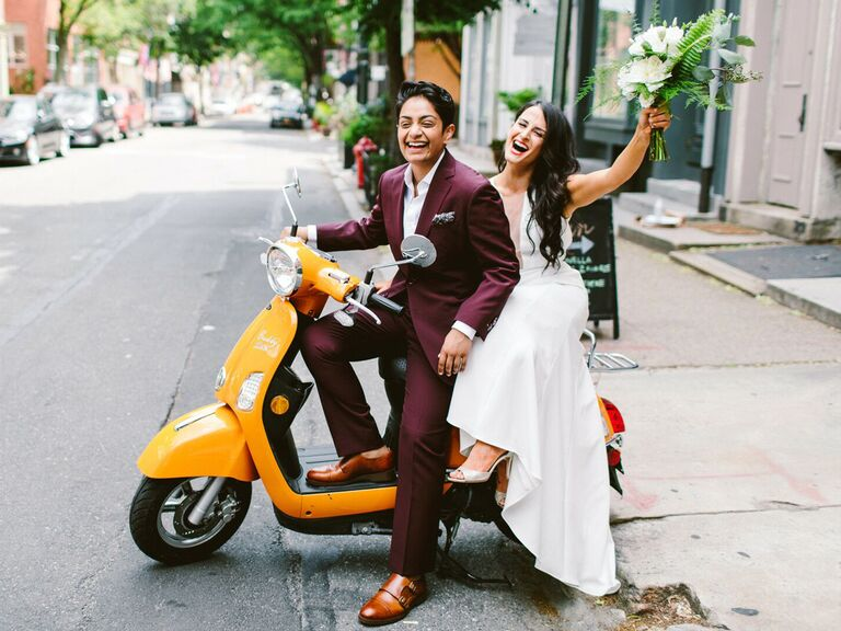 Brides on scooter after wedding