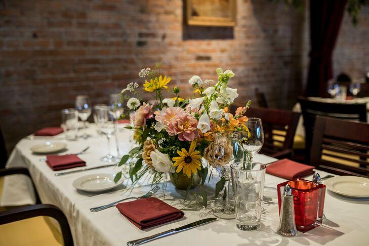 Romantic Flower Centerpieces at Industrial Restaurant Reception