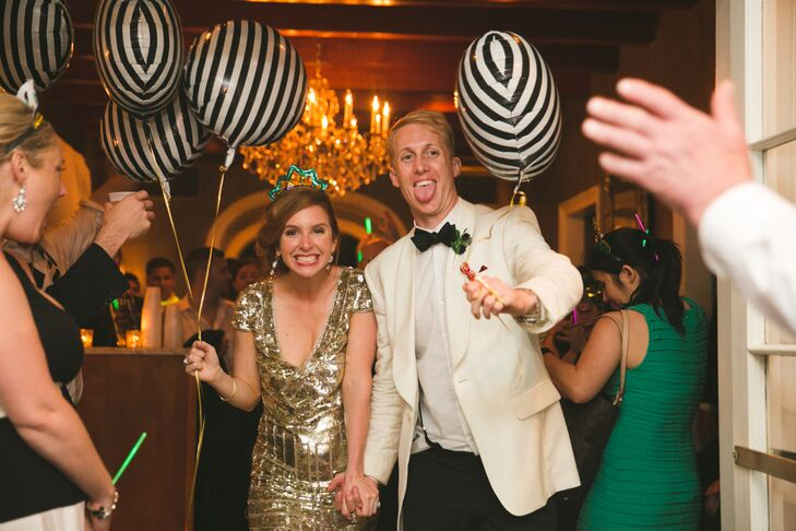 After Virginia changed into a gold sequined cocktail dress, the couple departed their reception with striped balloons in hand.