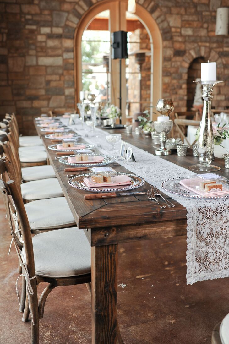 To set the head table apart from the myriad of round tables filling the  stone banquet hall, Courtney and Jack sat themselves and their wedding party at a long wooden farm table decorated with lace table runners and pretty pewter accents.