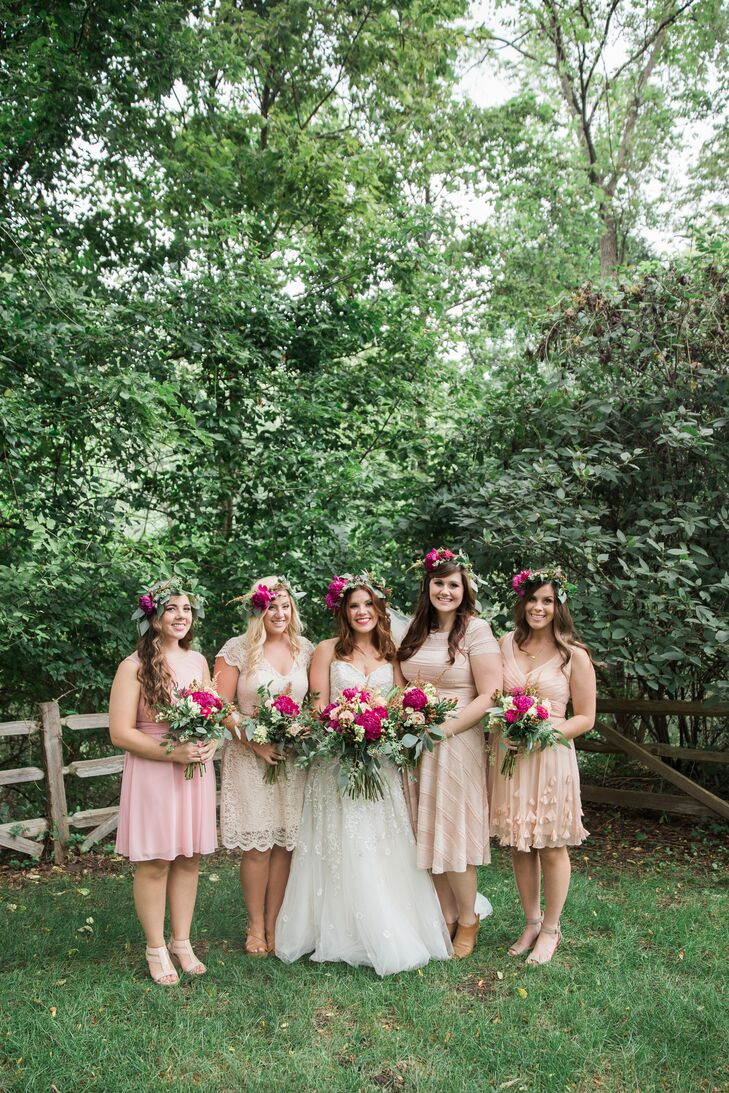 The bridesmaids' mismatched neutral dresses were paired with coordinating flower crowns for a distinctive yet cohesive look.